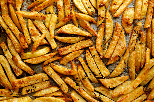 Homemade french fries in oven, crispy and delicious
