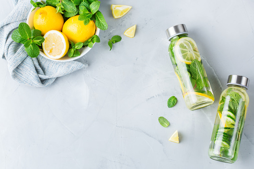 Detox water with lemons cucumbers and mint leaves